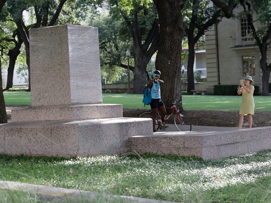 """A pedestal wrapped in plastic that had held a statue of Confederate Gen. Robert E. Lee which was removed from the University of Texas campus early Monday morning is photographed, Aug. 21, 2017, in Austin, Texas. University of Texas President Greg Fenves ordered the immediate removal of statues of Robert E. Lee and other prominent Confederate figures from a main area of campus, saying such monuments have become """"symbols of modern white supremacy and neo-Nazism."""""""