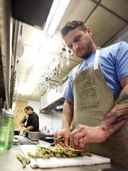 Chef Jonathan Kastner prepares for dinner service during his first day on the job at Cafe Vermilionville Monday, June 1, 2015, in Lafayette, La.
