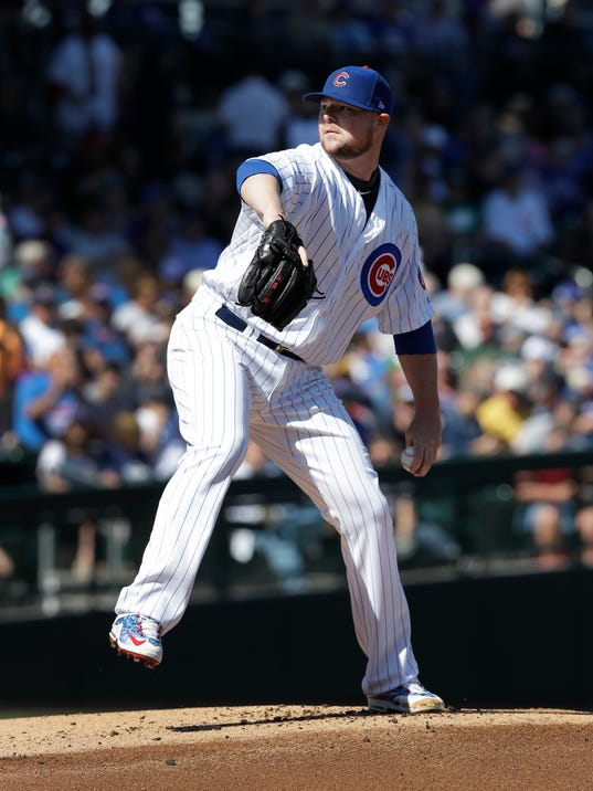 Chicago Cubs starting pitcher Jon Lester throws during the first inning of a spring training baseball game against the Chicago White Sox, Tuesday, Feb. 27, 2018, in Mesa, Ariz. (AP Photo/Carlos Osorio)