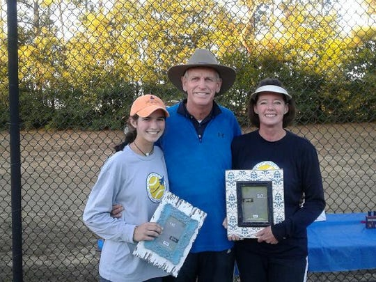 From L to R: Daughter Elizabeth Nowak with tourney founder Brian Sakey and her mother Bronagh Nowak after winning the doubles championship. Photo by Mac