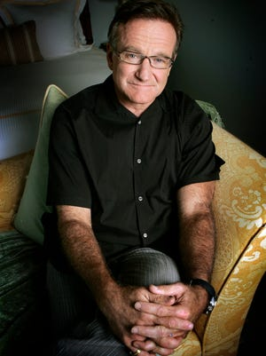 """This 2007 photo shows actor and comedian Robin Williams posing to promote his film, """"License To Wed"""" in Santa Monica, Calif."""