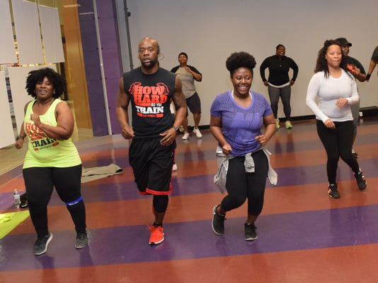 Steve Ranel (center), owner of 300 Fitness, conducts a free S.W.E.A.T. class at the Alexandria Mall Saturday. Another free S.W.E.A.T. class is set to be held at 11 a.m. next Saturday in the old Foot Locker location. A workout mat is recommend. S.W.E.A.T. s