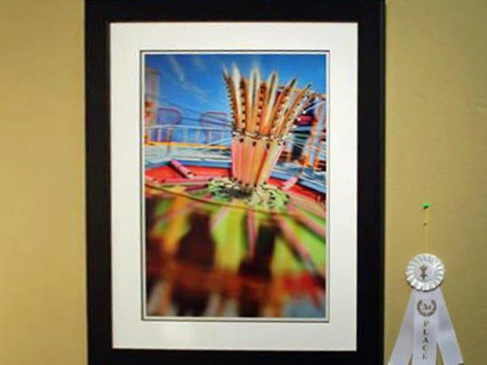 """Tom Dent took third place in the SVA Golden Frame Awards for his piece """"Tilt-A-Whirl."""