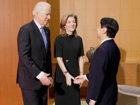 Vice President Joe Biden, left, accompanied by U.S. Ambassador to Japan Caroline Kennedy, center, is greeted by Japan's Crown Prince Naruhito upon his arrival at the Togu Palace in Tokyo Tuesday.
