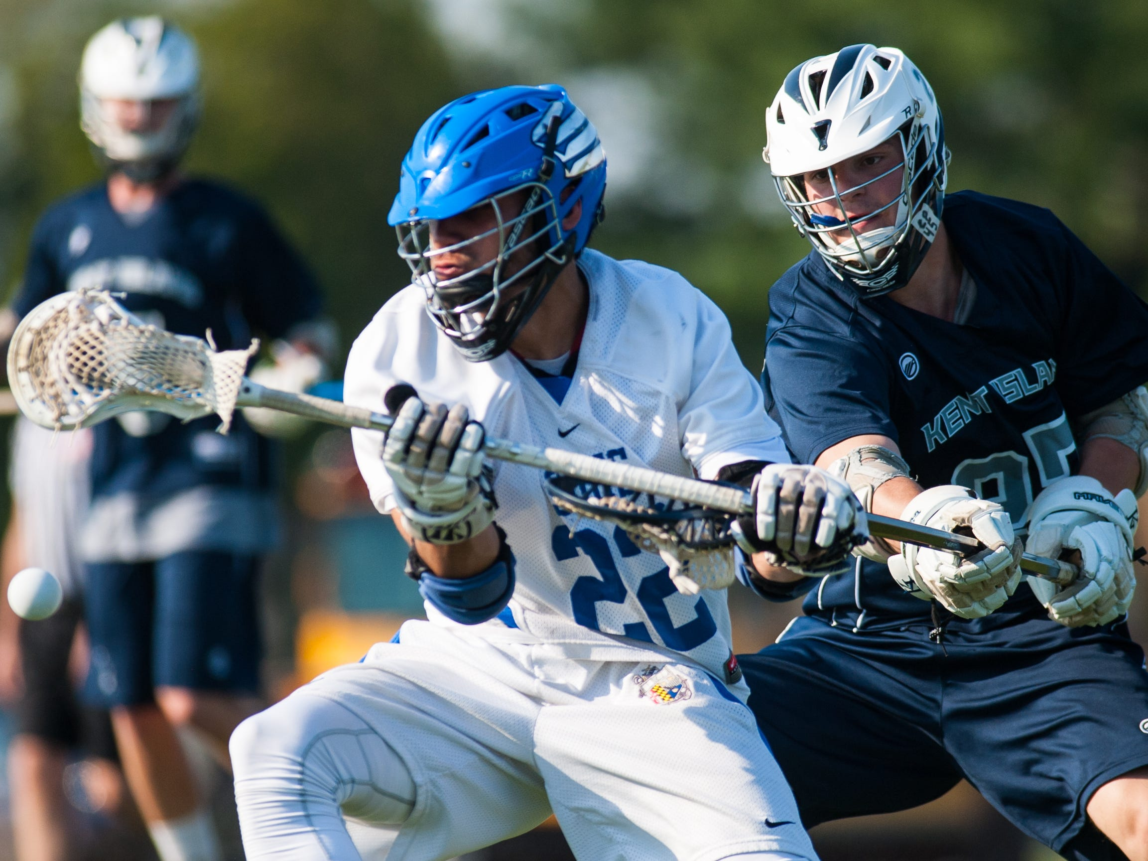 Stephen Decatur midfielder Matt LeCompte (22) is stripped by Kent Island defender Mike McCaslin (27) on Tuesday evening at Wicomico County Stadium in the Bayside Lacrosse Championship.
