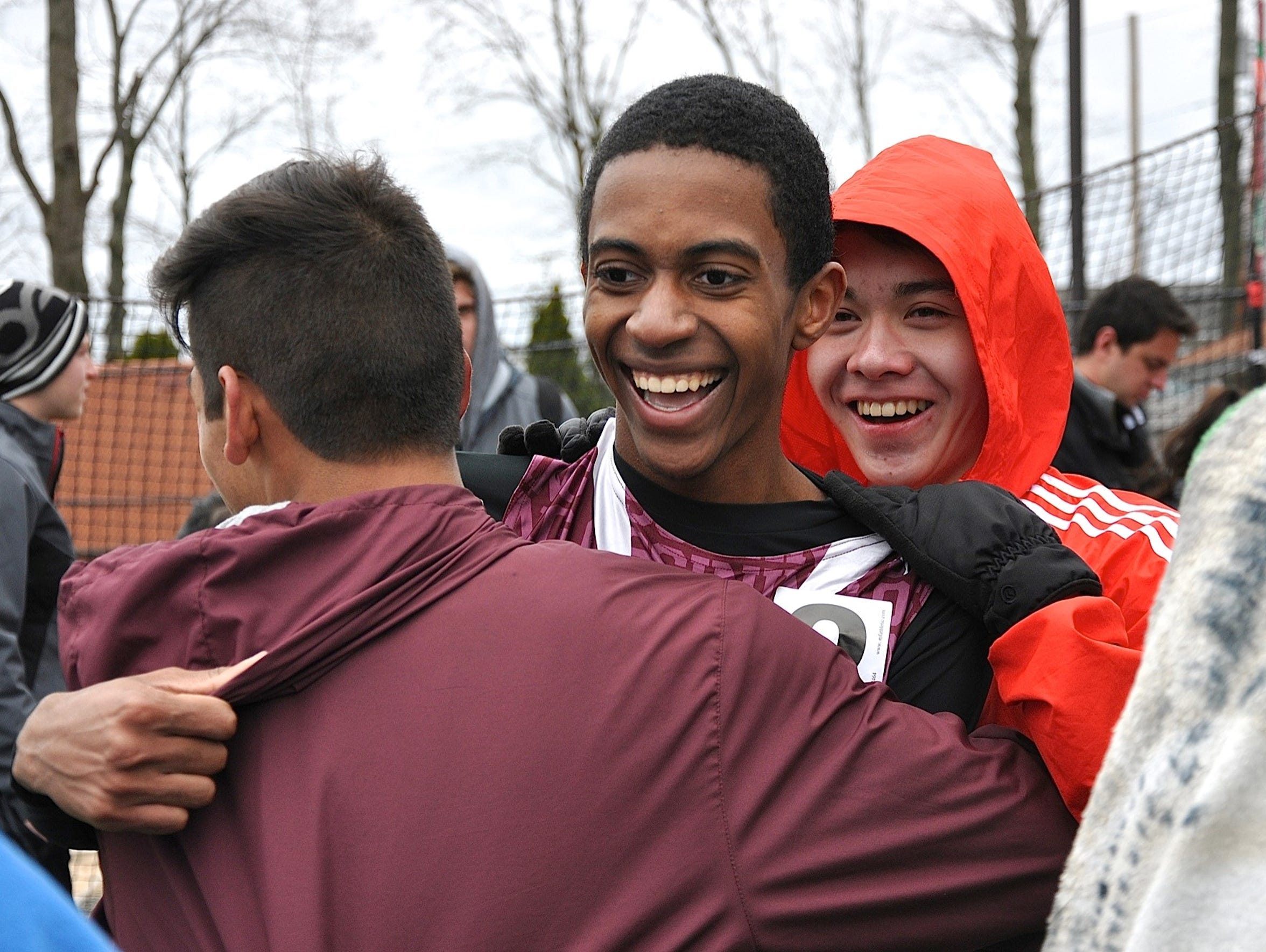 Ossining's Patrick St. Ange is hugged by friends after