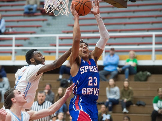 Spring Grove's Eli Brooks (23) gets a shot off against East Stroudsburg North in a second-round PIAA basketball game Friday. Spring Grove defeated East Stroudsburg North, 65-55.