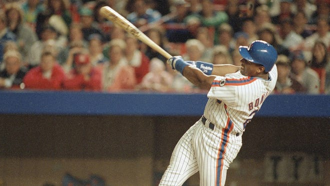 New York Mets Bobby Bonilla busts out of his hitting slump with this swing, to gave him a grand slam against the San Francisco Giants in the second inning, June 1, 1992 at New York's Shea Stadium.