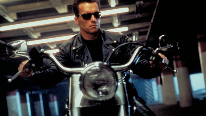 """Astride his Harley-Davidson Fat Boy, Arnold Schwarzenegger's character in """"Terminator 2"""" exemplifies the macho image that has helped build the Harley brand."""