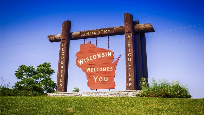 A sign welcomes visitors to Wisconsin. America's Dairyland has welcomed more tech workers in recent years. Madison, Wisconsin, added 6,270 tech talent jobs in the last five years, a 39.5 percent increase.