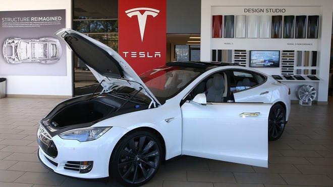 A Tesla is shown in Palo Alto, Calif., in this June 2018 file photo.