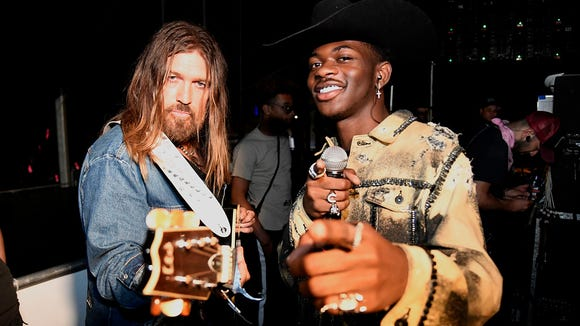 """Y'all really boycotting wrangler?"" asked Lil Nas X on Twitter after customers threatened to boycott the denim brand over its partnership with the ""Old Town Road"" rapper."