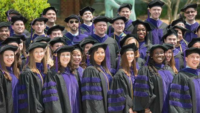 A graduation at Antonin Scalia Law School at George Mason University, where controversy arose over major donations, including $10 million from the Charles Koch Foundation that called for renaming the law school for the Supreme Court justice.