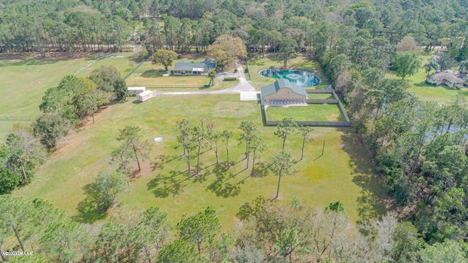 In addition to holding a beautifully maintained and updated home, this five-acre property has an active dog and cat boarding and grooming kennel.