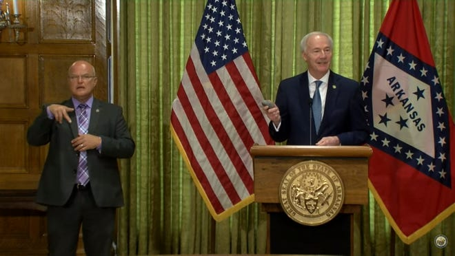 Gov. Asa Hutchinson held up a rock that had been thrown during the Little Rock riots on Tuesday.