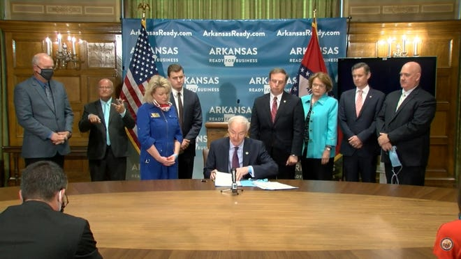 Gov. Asa Hutchinson signed three executive orders on Monday to protect Arkansans from COVID-19 litigation.