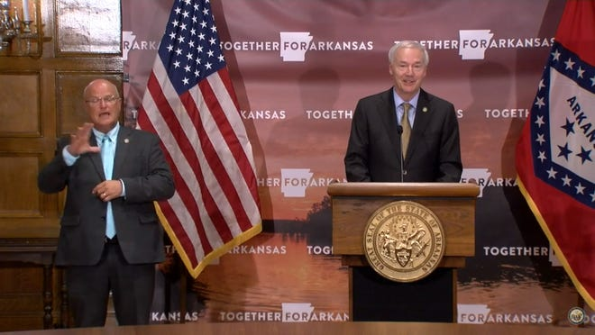 Gov. Asa Hutchinson speaks to reporters Thursday at the Arkansas State Capitol.