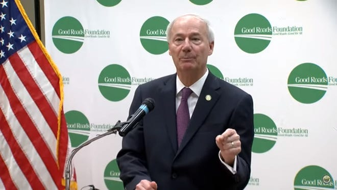 Gov. Asa Hutchinson spoke at the Good Roads Foundation to promote Issue 1.