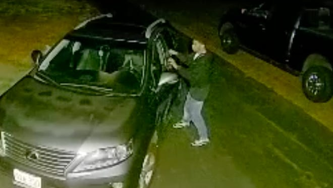 This image from a Ring video shows a man attempting to open the door of a vehicle parked in a Millis driveway. This photo was released by the Millis Police Department in the middle of August.