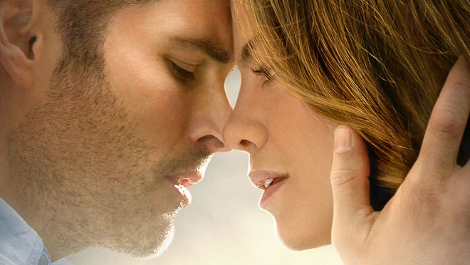 """James Marsden and Michelle Monaghan kiss in a scene from """"The Best of Me."""""""