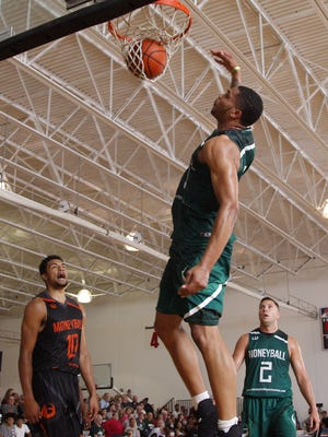 Miles Bridges dunks as Kenny Goins, left, and Bryan Dutton, (2) watches during the Moneyball Pro Am Finals Thursday, Aug. 3, 2017, at Aim High.