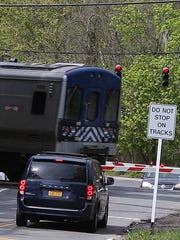 A southbound train passes the Commerce Street crossing