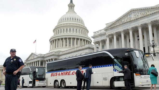 Senators board a bus Wednesday on Capitol Hill, heading to the White House to get a briefing on North Korea.