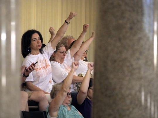 "Abortion rights activists seated in the Missouri House react after lawmakers approved a sweeping piece of anti-abortion legislation, a bill that would ban most abortions in the state of Missouri on Friday, May 17, 2019. The final vote was 110-44, and the proposal now heads to Gov. Mike Parson, a Republican, who is expected to sign the measure. Activists chanted from the chamber gallery. ""When you lie, people die."" (Christian Gooden/St. Louis Post-Dispatch/TNS)"