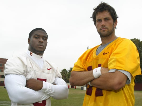 Running back Reggie Bush and quarterback Matt Leinart of the USC Trojans pose for a portrait during a USC team practice on the USC campus on August 16, 2005, in Los Angeles, California. (Photo By Christian Petersen/Getty Images)