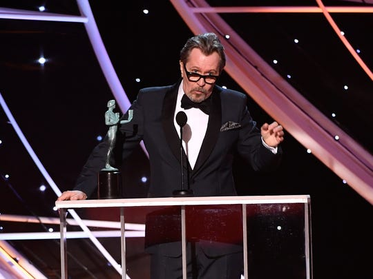 Gary Oldman accepts the award for lead actor for his