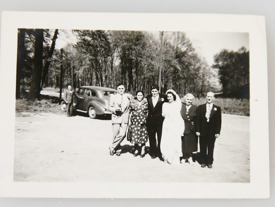 Guy Call, on the left, the day of his eldest son's James marriage to Helen Petrilli. From the left, Guy and Philomena,  James and Helen, the writer's parents, and Maria and Cesar Petrilli.