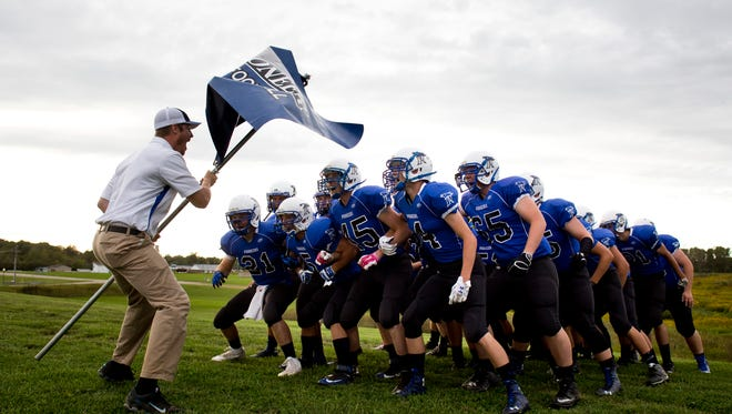 Cros-Lex players prepare to take the field during a football game Friday,