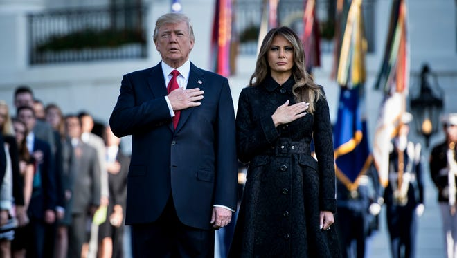 President Trump and First Lady Melania Trump observe a moment of silence at the White House Monday on the 16th anniversary of 9/11.