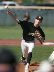 Howell's Ty Weatherly pitches in the fifth inning of a 2-1 loss to Plymouth in the KLAA baseball championship game on Wednesday, May 23, 2018.