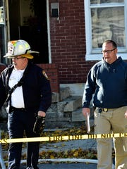 In this 2015 file photo, Chambersburg Fire Chief Butch Leonhard, left, and the state police fire marshal, Frank Hershey, investigate a fire at 29 S. Franklin St., Chambersburg.