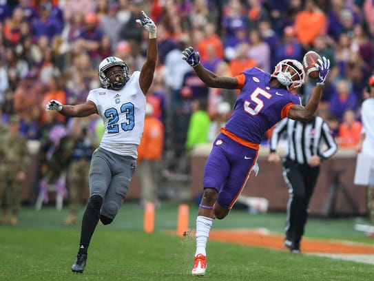 Clemson wide receiver Tee Higgins (5) makes a one-hand catch on his way to scoring on a 71-yard catch and run against The Citadel Nov. 18 at Clemson's Memorial Stadium.