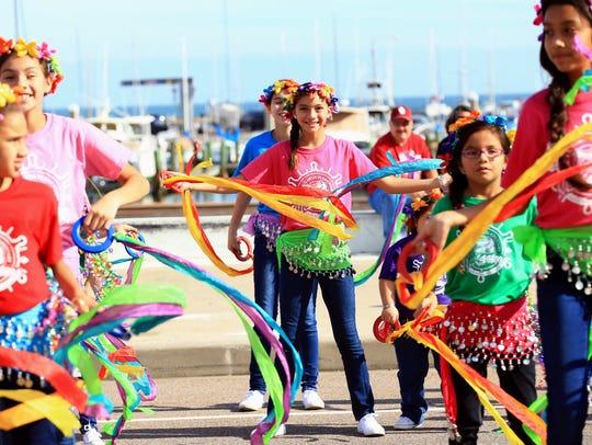Children from Garcia Elementary School perform during