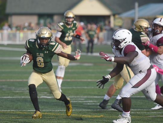 St. Joseph's Andre Johnson (8) try to evade Don Bosco