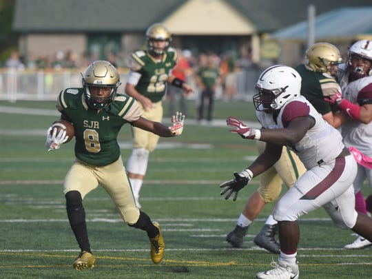 St. Joseph's Andre Johnson (8) try to evade Don Bosco defenders on Saturday, Oct. 7, 2017.