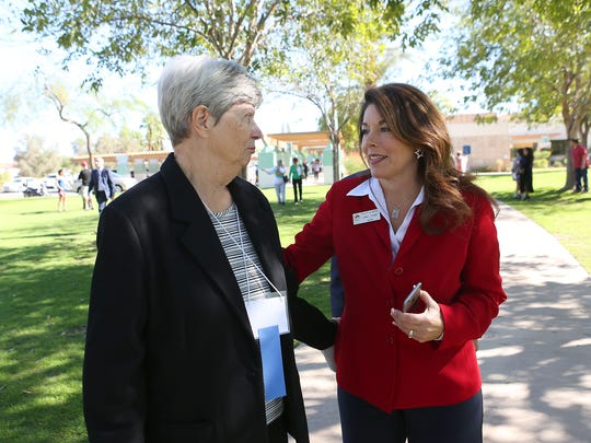 La Quinta Mayor Linda Evans, right, chats with Kay Ruttman, whose husband Bert Ruttman died before Wednesday's Veterans Day Tribute where he was among 31 veterans recognized.