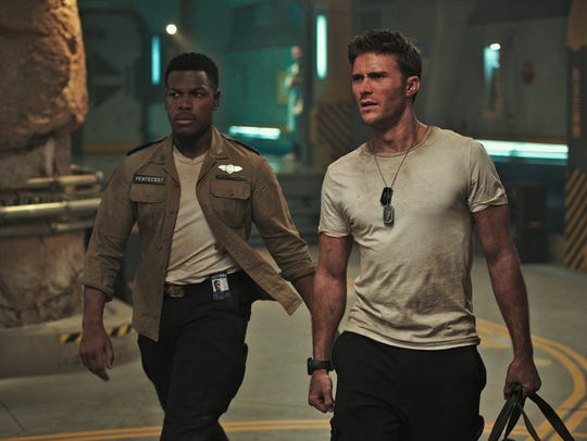 John Boyega (left) and Scott Eastwood are mech pilots