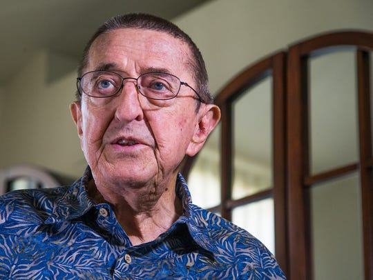 Leonard Rodgers, 80, of Tempe, Arizona, gets help with