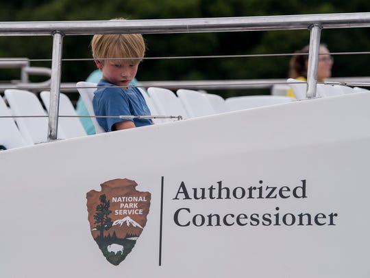 The Apostle Islands Cruises boat built by Sentinel Marine in Wetumpka, Ala., takes dignitaries on a ride on the Alabama River in Montgomery, Ala. on Friday July 6, 2018 before heading to its home in Wisconsin.