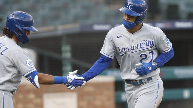 Kansas City's Adalberto Mondesi (27) celebrates with second baseman Nicky Lopez (1) after scoring a run during the second inning against the Detroit Tigers Wednesday night at Comerica Park. The Royals built a 4-0 lead early but fell 5-4.