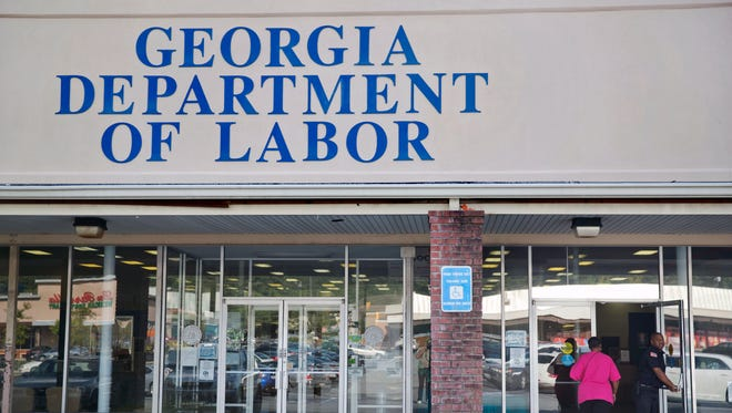 A woman walks into a Georgia Department of Labor career center, Friday, Sept. 19, 2014, in Atlanta. Georgia reported the nation's highest unemployment rate in August, at 8.1 percent. That's the first time Georgia has had the highest rate since the Great Recession ended.