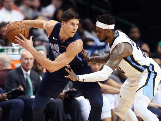 Dallas Mavericks forward Doug McDermott (20) looks to score as Memphis Grizzlies guard Ben McLemore (23) defends during the second half at American Airlines Center.