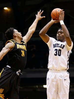 Butler's Kelan Martin shoots against Kennesaw State's Orlando Coleman in the second half of the game at Hinkle Fieldhouse Monday December 8, 2014. Butler won 93 - 51.