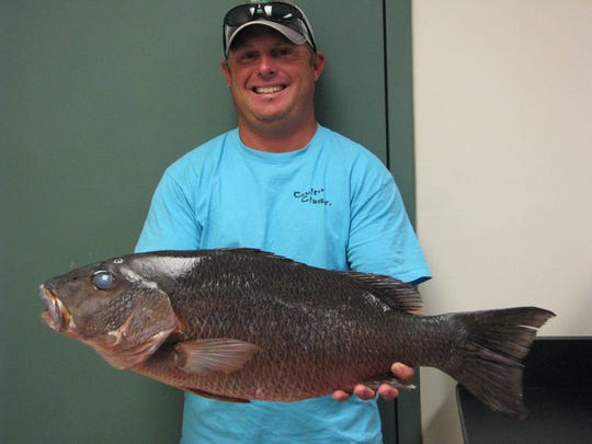 Donald Bosarge, II, caught the Mississippi gray snapper record with this 15-pound, 4-ounce fish.