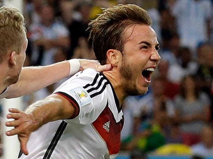 Germany's Mario Goetze celebrates after scoring the opening goal during the World Cup final soccer match between Germany and Argentina at the Maracana Stadium in Rio de Janeiro, Brazil, Sunday, July 13, 2014. (AP Photo/Victor R. Caivano)