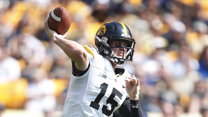 Iowa Hawkeyes quarterback Jake Rudock (15) passes the ball against the Pittsburgh Panthers during the first quarter at Heinz Field.